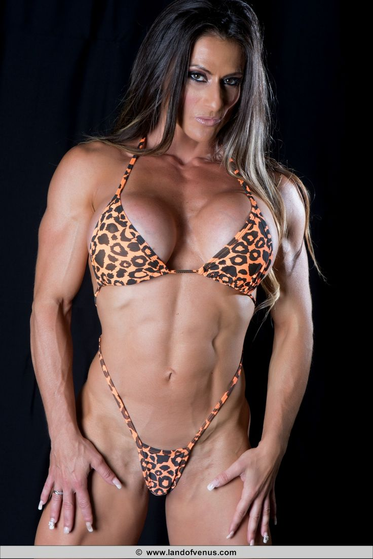 image Strong muscular brunette sheila bleck rips her shirt and flexes for you