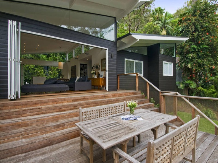 Grey cladding, silver windows and natural timber deck. Want deck like this with big full length steps