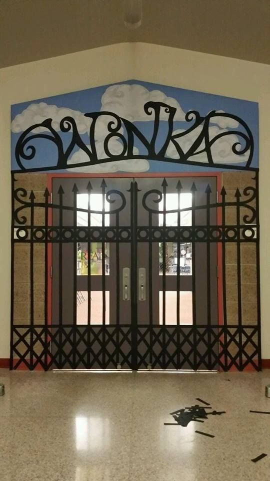 Created the Willy Wonka factory gate with tag board and paper on school library doors for their book of the month.