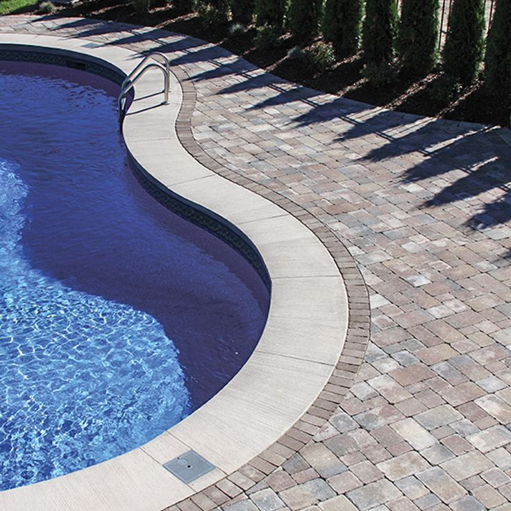 Poolside landscape. Project application using Wexford pavers. Color: Wexford Sandalwood by Oaks Landscape Products.