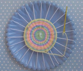 paper plate weaving - a good way to teach kids basic sewing dexterity!