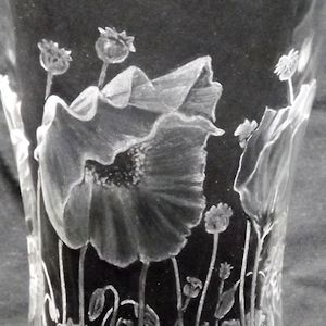 HOW TO ADD SHADE TO YOUR GLASS ENGRAVING Poppies engraved onto a glass vase by Paul Amphlett. The shading was done with Eternal Tools green stone burrs and silicone wheel polishers. In this article we follow Paul's journey to enhance his shading skills. he tells us the tools he used along with some helpful tips plus shares his 'before and after' images of his glass engravings