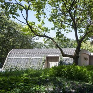 Ambulance+station+by+Architectenforum+features+plant-covered+walls+and+a+curved+roof