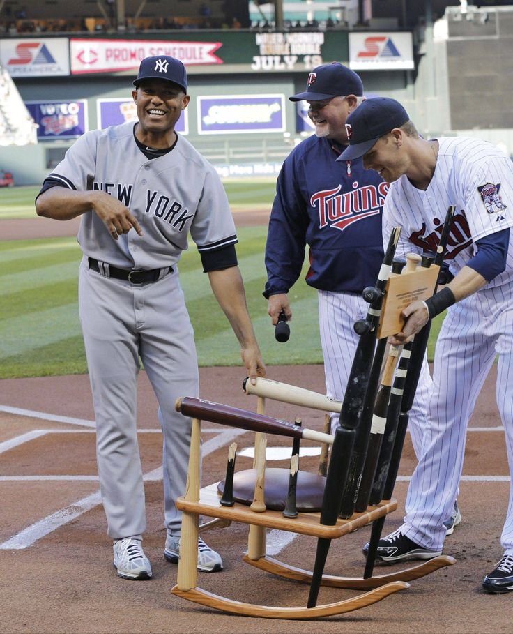 Minnesota Twins gift retiring Yankee pitcher Mariano Rivera a rocking chair made with bats he has broken over his career.