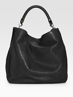Yves Saint Laurent - every woman needs a black purse