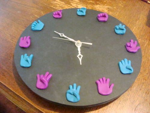 ASL clock. I bet you could make this, @Ashley Christine. Could be really great for a classroom!