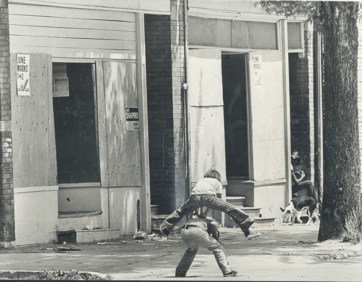 This summertime picture from 1974 shows a very common sight (back then): Kids playing outside in the streets. Nearby, a man and his dog take the air. I like to think they were on their way to the Summer Reading Club at a nearby library. The campaign signs, which you can see on the boarded-up building nearby, indicate that this is the Spadina riding (won that year by Liberal Peter Stollery). Courtesy: Toronto Star Photo Archive.