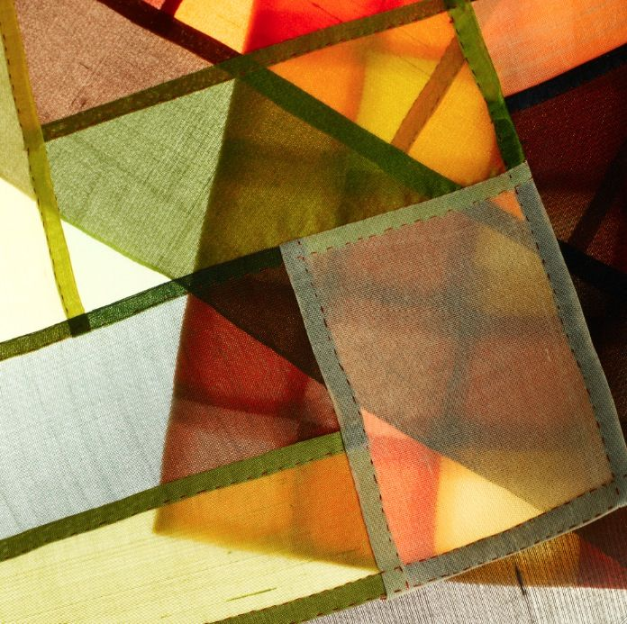 Stained Glass Effect -  When Jogakbo is installed on a window, its effect embodies the concept of a stain glass. The sunlight lights up the colors and emphasizes the overlapped edges of the squares. But since Jogakbo is made from natural materials, it gives off a softer light than a traditional stained glass. It can be called 'fabric stained glass' as a new concept of window treatment.