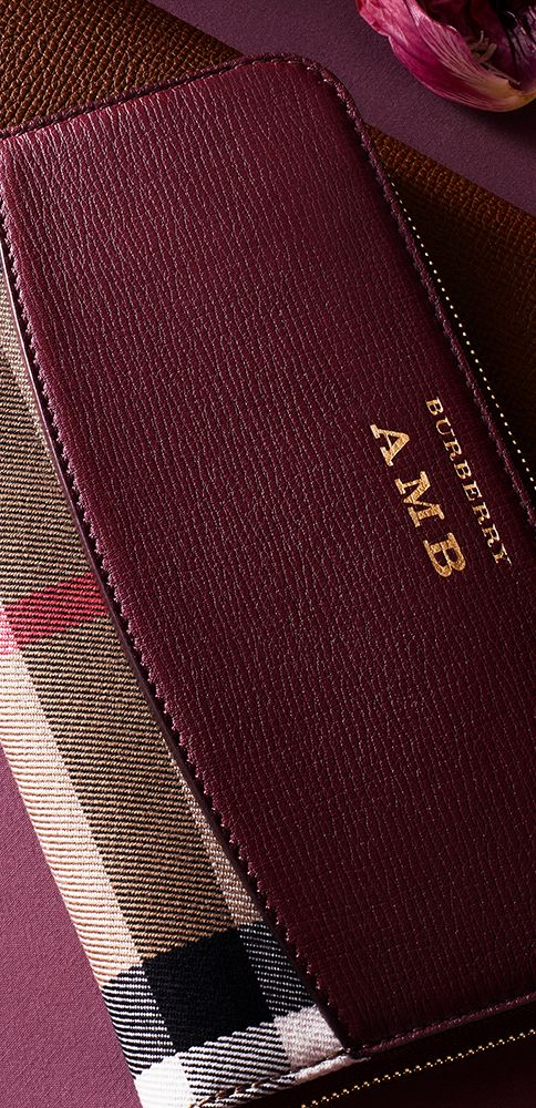 Burberry zip-around wallets in leather, detailed with our house check. Add an embossed monogram with up to three initials to customise your wallet or create a personalised gift.