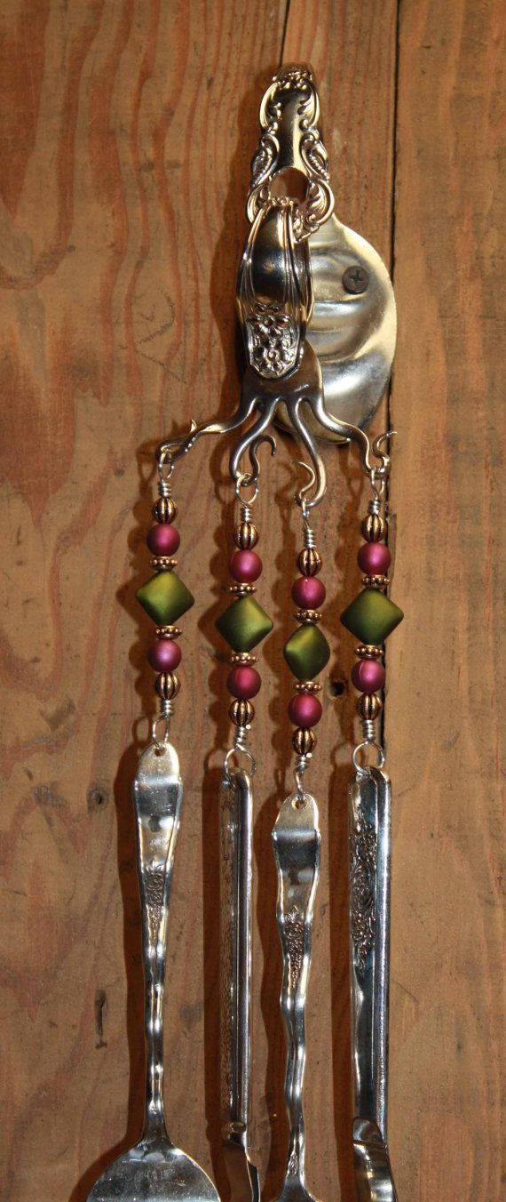 On a breezy day listen to these beautiful sounding wind chimes.  These wind chimes come as shown  wall bracket, screws and the color of beads shown on the silverware.