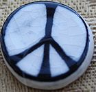 The first peace badge, 1958, made in ceramic for the Campaign for Nuclear Disarmament by Eric Austen from Gerald Holtom's original design