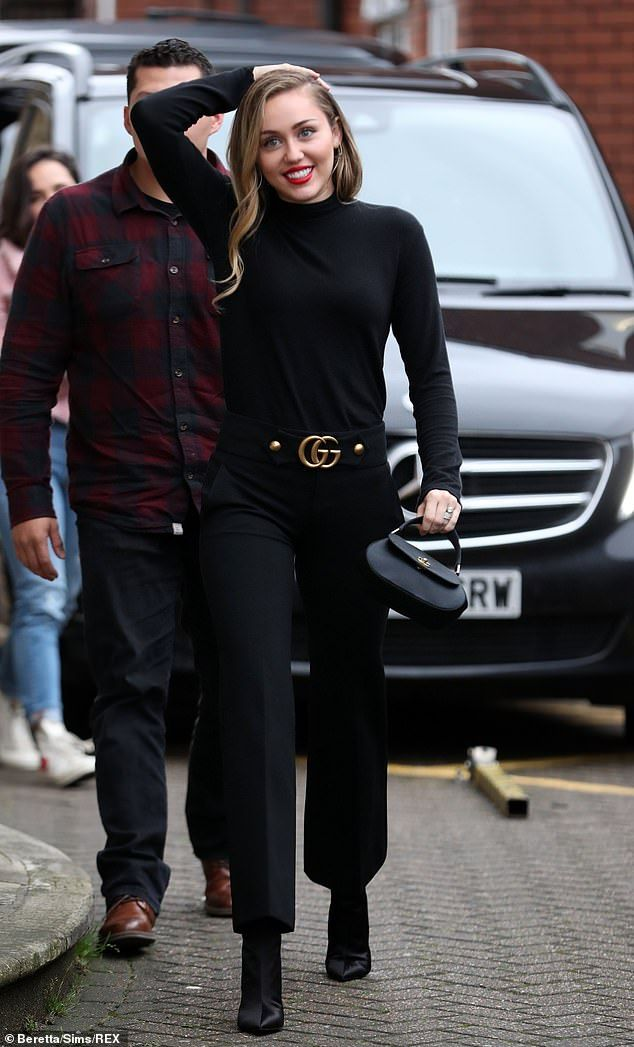 f26c01c194c15f Make like Miley in black Gucci trousers  DailyMail