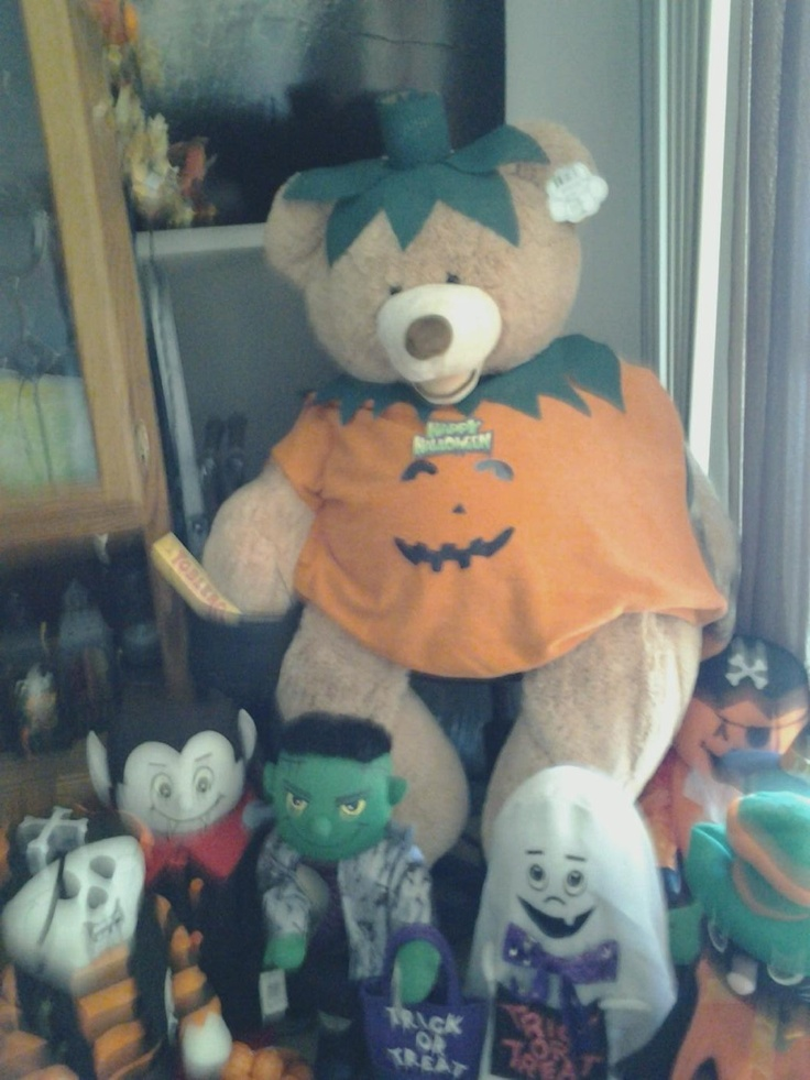 giant teddy bear.d.i.y costume.orange bath towel,black paper,white paper(for the banner) and anti slip mat under rug(the only green i have so i use it)