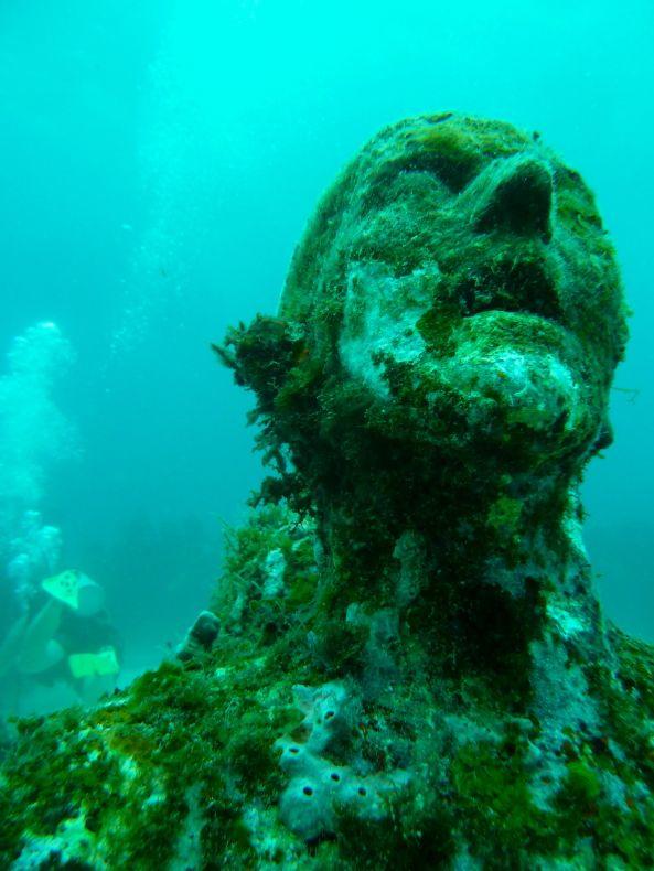 Poseidon's Adventure: Cancun's Underwater Museum -http://www.pointsandtravel.com/poseidons-adventure-cancuns-underwater-museum/