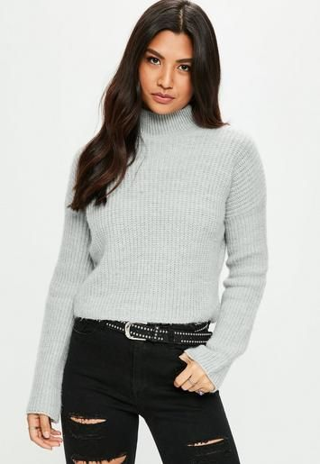 A ribbed knitted jumper in a grey hue with high neck and soft cosy feel.