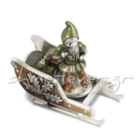Santa Claus's elf on a Christmas sleigh. Silver-plated copper. Coloring with natural oxidation. By Shine4ever.gr