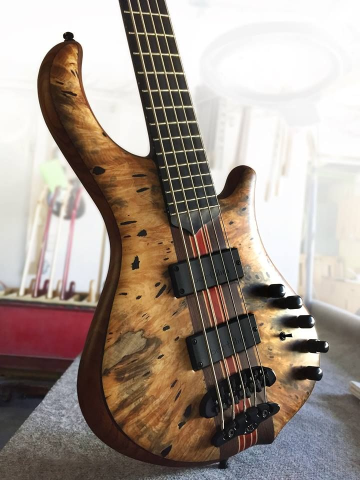 Mayones Slogan 5 Custom Shop Bass, Buckeye Burl top, Swamp Ash T.E.W. body back with Wenge middle, 9-ply Wenge / Padouk/ Maple neck-thru-body section, Two additional graphite rods, Transparent Natural Satine finish, Ebony fretboard