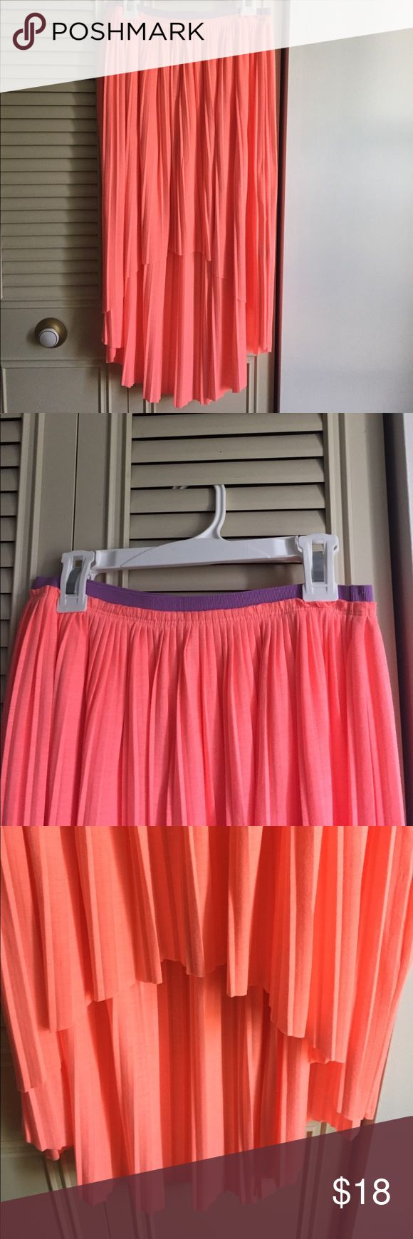 AMERICAN EAGLE HIGH LOW SKIRT This is a vibrant coral high low skirt from American Eagle. It is an extra small and has a stretchy elastic band. It features a muted purple elastic band at the top to contrast the vibrancy of the coral. It looks very beautiful on and it's perfect for the spring! American Eagle Outfitters Skirts High Low