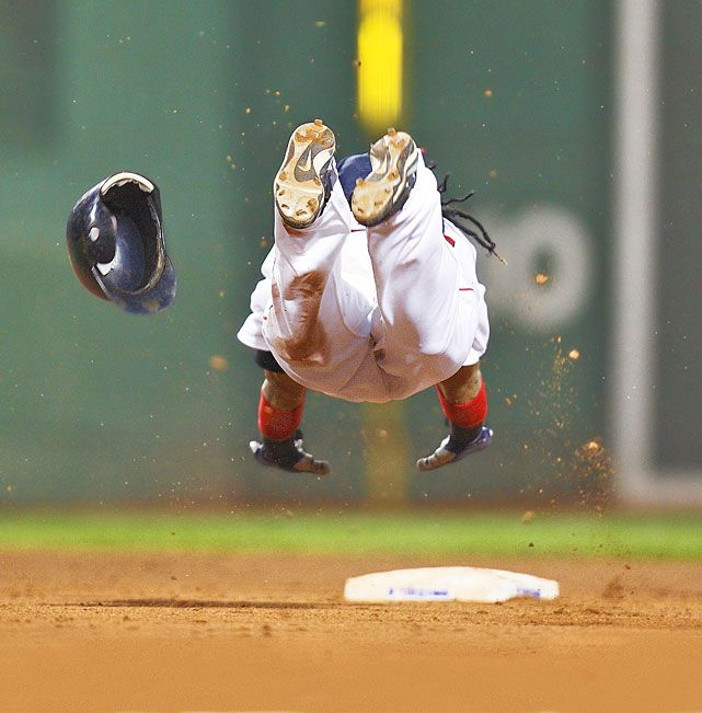 Happy 40th birthday Manny Ramirez. In this 2007 photo, the Red Sox outfielder dives safely into second base during a game against the Yankees. (Damian Strohmeyer/SI)  GALLERY: Manny Ramirez at 40