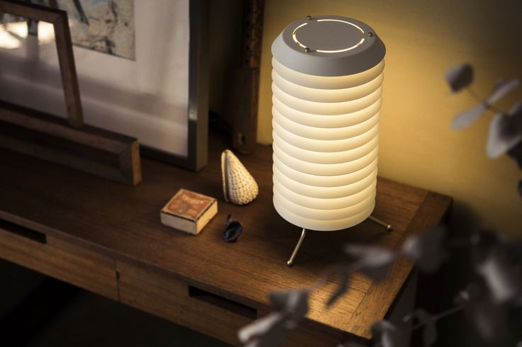 Maija's light hangs out from a shimmering honeycomb, shrouded in warm life #Tapiovaara