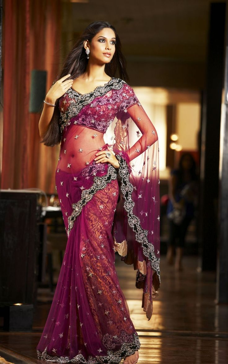 Rich plum Net #Saree with emerald green velvet border embellished with swaroski crystal work