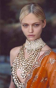 The uncut diamond layered jewelry against rust colour