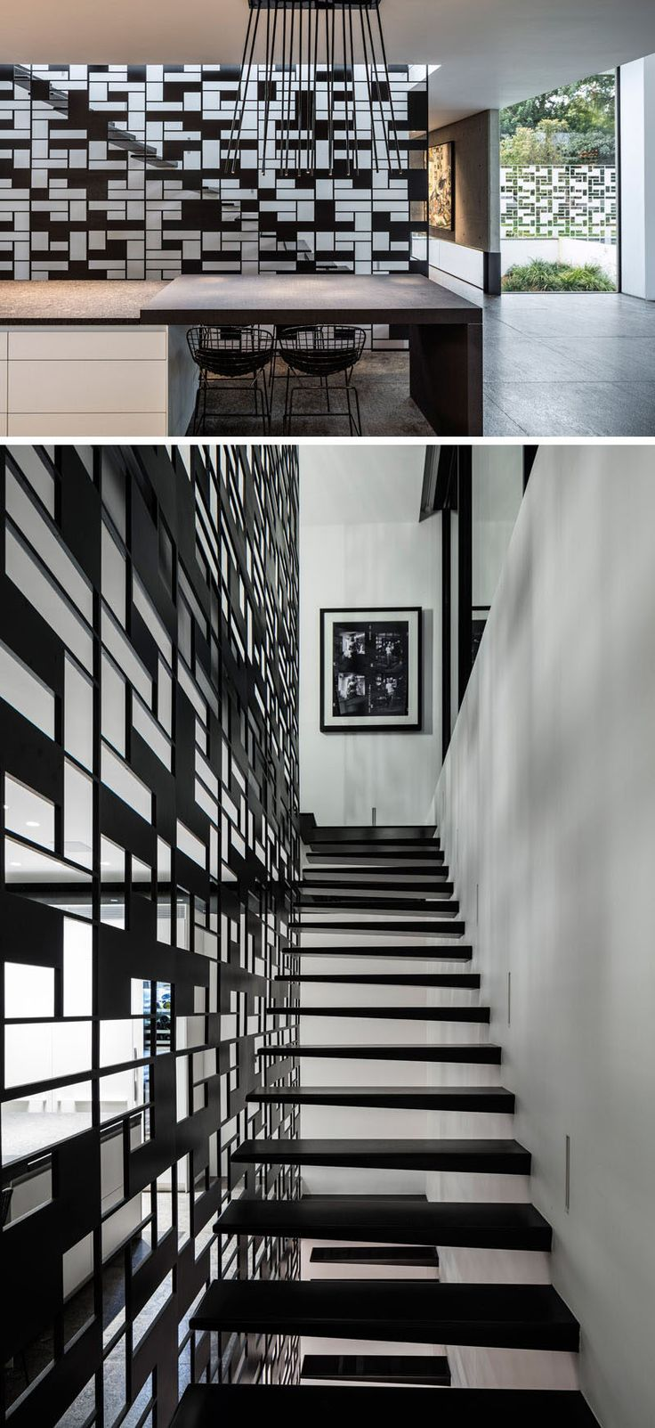 The black metal safety railing protecting one side of the staircase matches the design of a white fence that surrounds the house, creating continuity throughout the house and adding extra safety to the stairs.