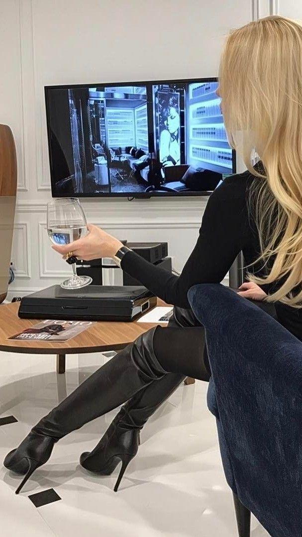 Blonde in black OTK boots