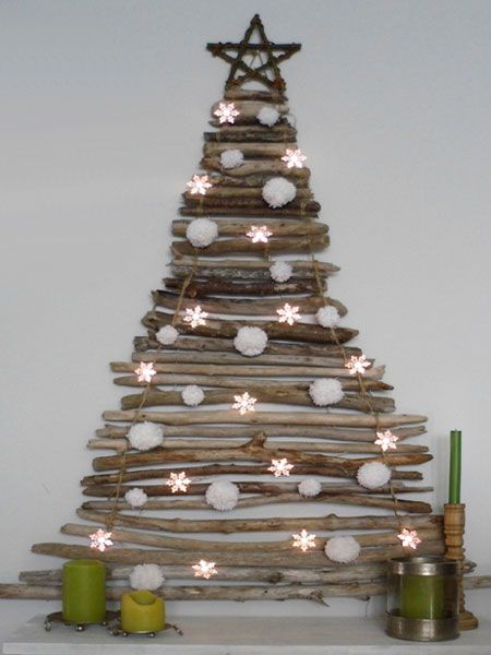 Home-Dzine - Alternative and recycled Christmas  Would need to mount to a board to lean againt the wall for apartment use.  I like this tree.  If I had access to a saw and found branches I could totally do this on the cheap (also space to work in would be quite helpful!).