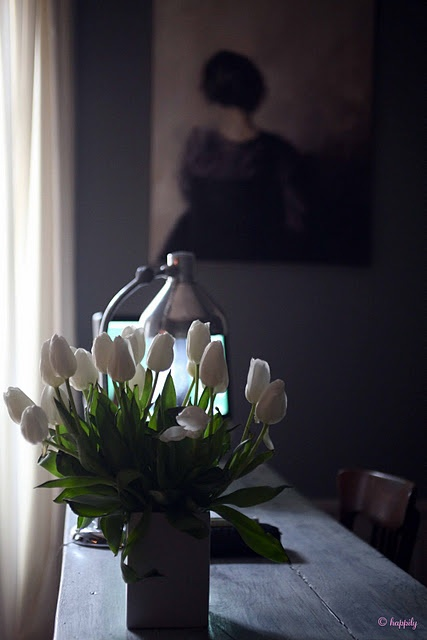 Fresh flowers always make a room that much warmer...  and I especially love these white tulips.