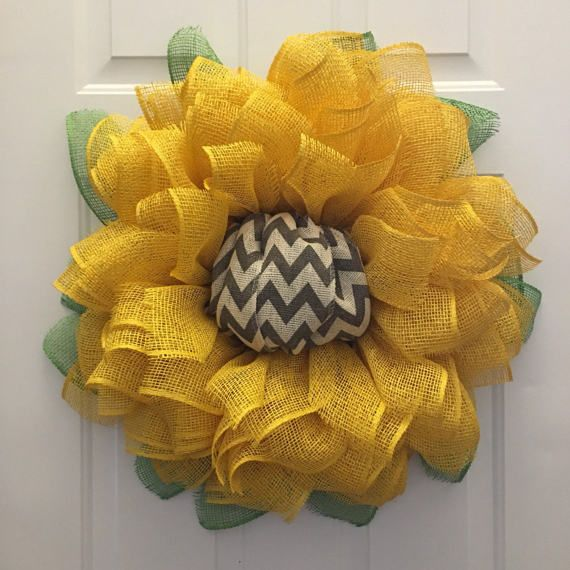 Thank you for looking at my Super Sized Sunflower Wreath. This wreath is 29-30 in diameter and comes with a chevron center for extra flare and originality. Make a statement on your front door today!  You may choose to have the center Brown instead of chevron as well with no additional charge. Please note that whenever you cut any type of burlap there will be some fraying and you may need to trim or pull out any loose strands from time to time.