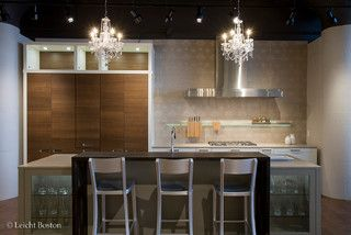 Leicht Boston Showroom - contemporary - kitchen - boston - by LeichtUSA.  U-shaped island with raised bar in the center, flanked with display cabinets.  Maybe this could be three tiered.