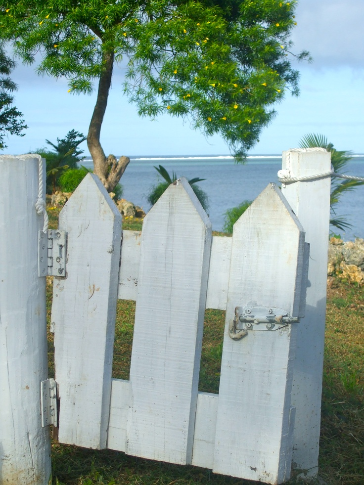 Have a thing about picket fences and gates - the view in the background is just as charming (Fiji).