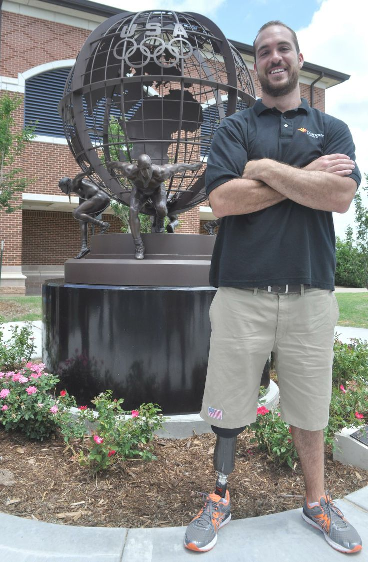 "UCO resident Paralympic athlete Jeremy Campbell poses beside ""Olympic/Paralympic Strength,"" which was dedicated Thursday in conjunction with the start of the 2014 UCO Endeavor Games."