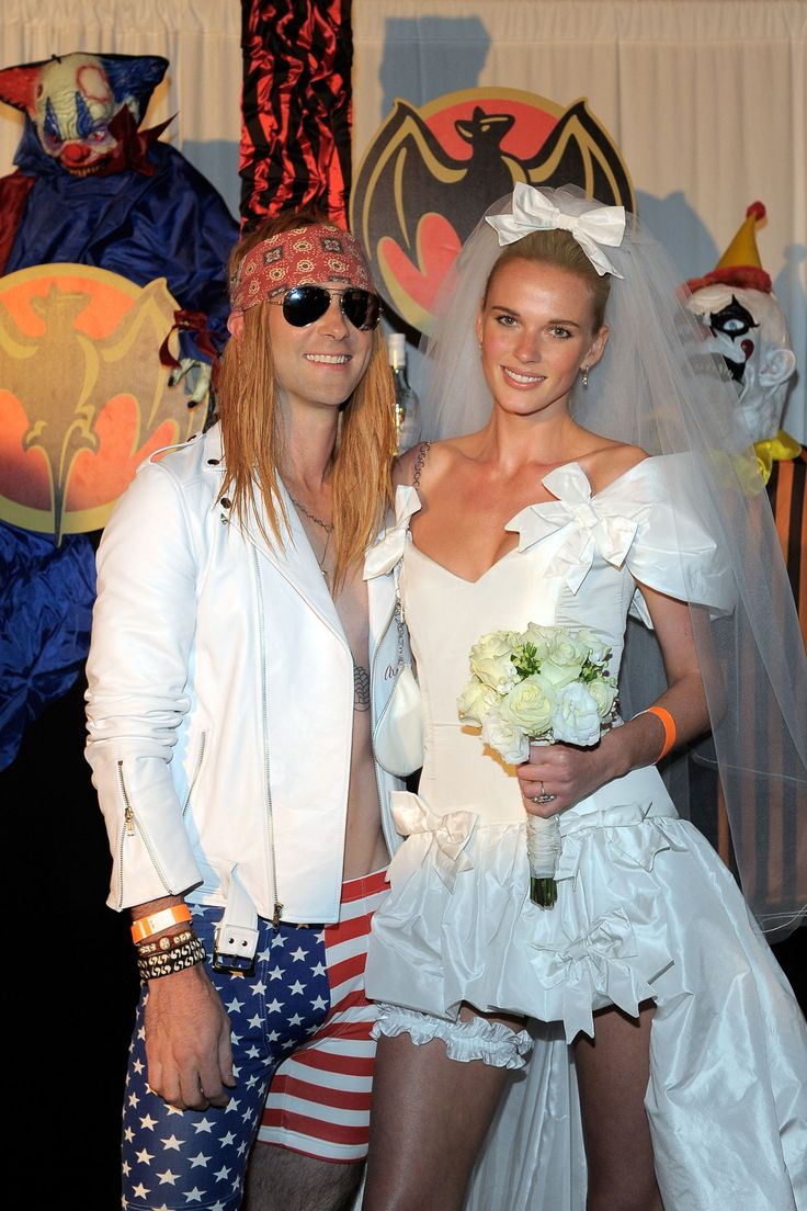 """Already started the search for the perfect Halloween costume? Use these iconic costumes worn by celebs for inspiration! See all our favorites here: Adam Levine and Anne V. as Axl Rose and Stephanie Seymour from Guns N' Roses music video """"November Rain"""""""