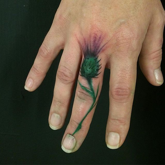 Thistle. Maybe not on the finger though