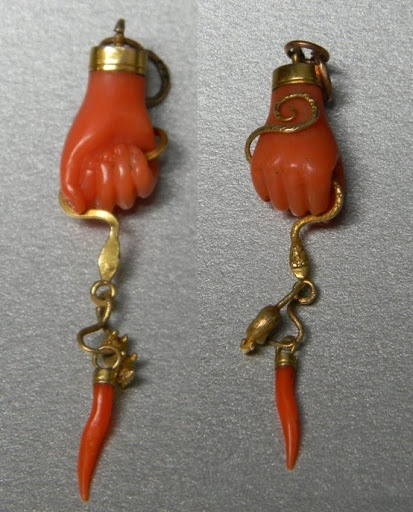 Italian good luck charms. Shake a fist (with the thumb tucked in) to say ciao to the malocchio.