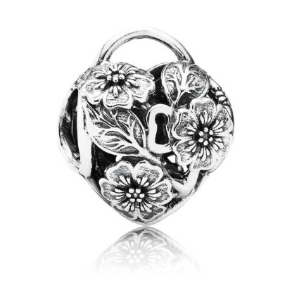 Pandora Silver Cubic Zirconia Floral Heart Padlock Charm 791397. A gorgeous Pandora charm from the new Autumn 2014 Collection set in sterling silver. Stunning detail has gone into this bead featuring a heart shape padlock design with a beautiful floral finish. The perfect gift for your loved one.