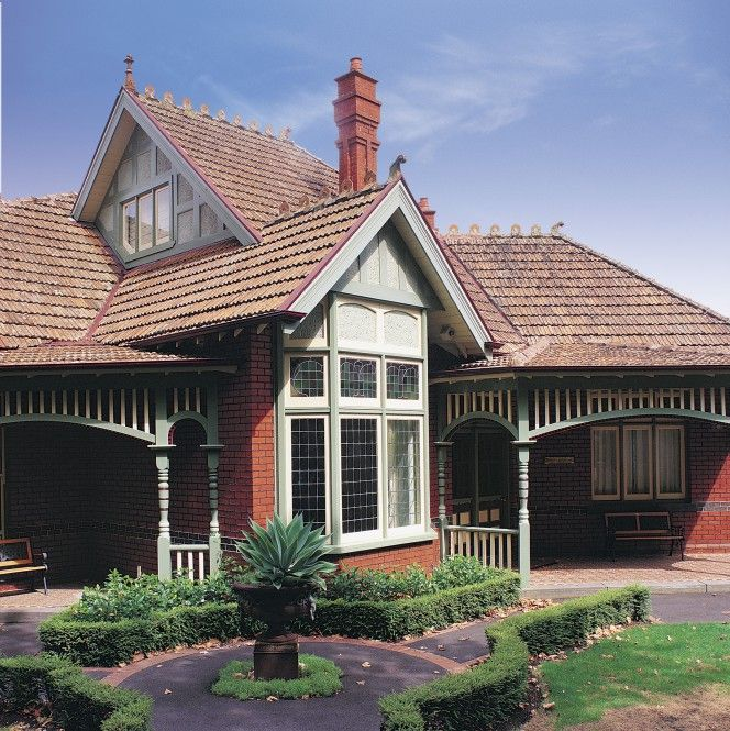 This red brick home in Australia is a great example of Federation style architecture. The purple and light green really complement each other in this front garden setting. Colours are by Dulux; Purple Brown, Grey Green, Lime White and Pale Vellum.