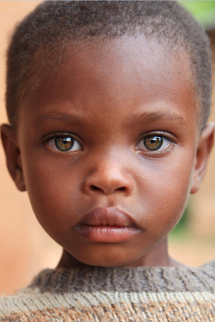Beautiful african child with green eyes