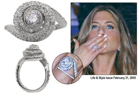 Jennifer Aniston's ring from Brad Pitt, who co-designed this ring with Silvia Damiani.  He wanted the ring to be tactile and the stones to be set on different levels. The center stone is D in color and flawless in clarity.