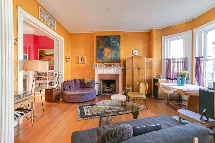 Eclectic Living Room with Crown molding, Hardwood floors, High ceiling, metal fireplace, Wall sconce