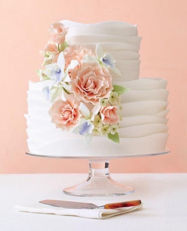 Romantic, ruffled wedding cake with sugar flowers