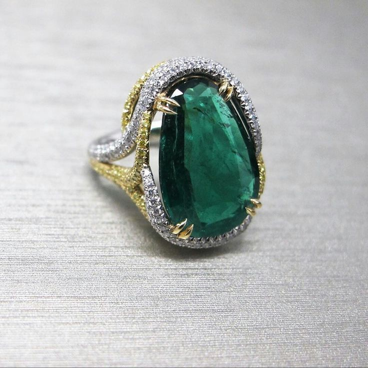 Simply enchanting! The stunning @Leibish emerald pear & yellow #diamond ring features a Gemfields Zambian emerald.