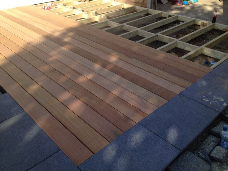 Fitting up Balau hardwood deck with black basalt stone surround
