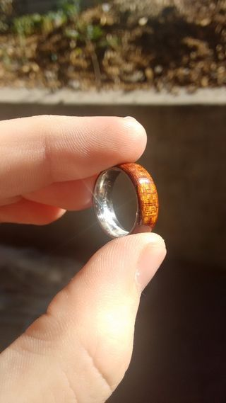 Bent wood rings are quite popular at the moment. This one is lined in stainless steel, so it won't wear out from the inside.