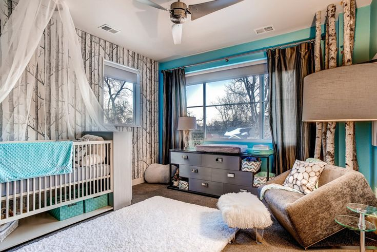 Contemporary woodland forest themed nursery with bold and bright turquoise accents.