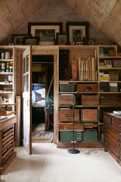 Bohemian Eclectic Rustic Organization: An artist studio's showcases built-in shelving and storage .