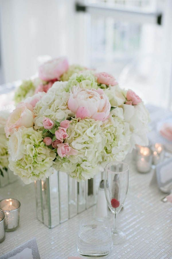 Modern wedding decor: pink peony and white hydrangea centerpiece with a mirrored vase (Margot Landen Photography)
