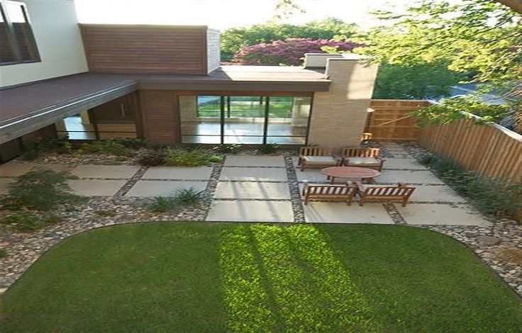 Large concrete patio pavers with river rock in between gaps